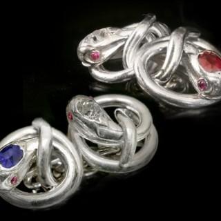 Ruby, sapphire and diamond set snake cufflinks, circa 1920.