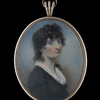 Portrait miniature of a Lady called Mary Brisbane, wearing black dress with white fichu, her dark hair worn long and curled