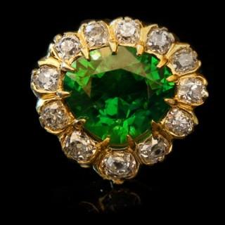 Rare demantoid and diamond coronet cluster ring, circa 1900.