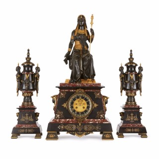 Egyptian Revival antique clock set by Emile Herbert