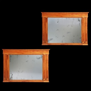 A pair of Neapolitan cherry wood overmantel mirrors