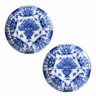 A pair of Delft blue and white plates