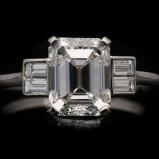Art Deco emerald-cut diamond flanked solitaire, English, circa 1930.