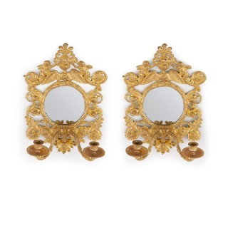 Pair of antique ormolu wall lights with mirrored backings