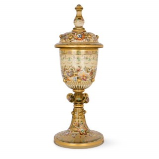 Parcel gilt and enamelled glass cup and cover by Moser