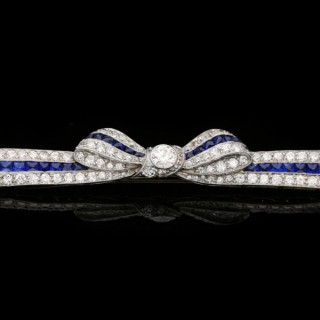 Marcus & Co. sapphire and diamond bow brooch, American, circa 1935.