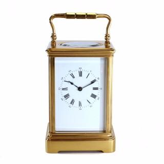 Antique Corniche striking carriage clock