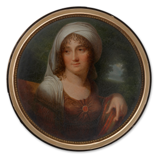Portrait miniature of a Lady, seated in a landscape, wearing brown dress and cornelian brooch, a white turban draped over her hair and shoulders, c.1805