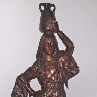 A patinated bronze sculpture of Rebecca by Gaston Leroux