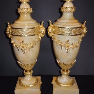 A pair of French ormolu mounted marble cassolettes