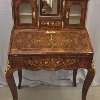 A Victorian ormolu mounted burr walnut bureau de dame