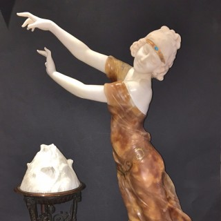 A very fine French alabaster and bronze lamp
