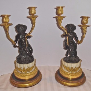 Pair of French gilt and patinated bronze candelabra