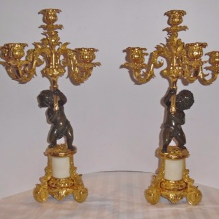 A French pair of Louis XV style candelabra