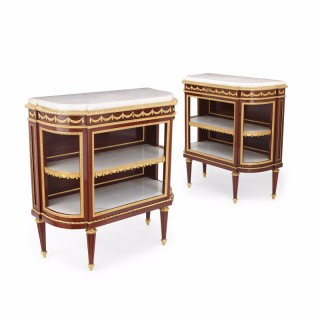 Pair of ormolu mounted mahogany desserte consoles by Dasson