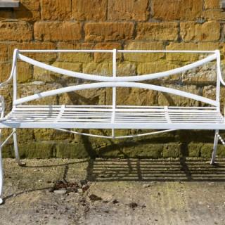 A 19th century wrought iron garden bench