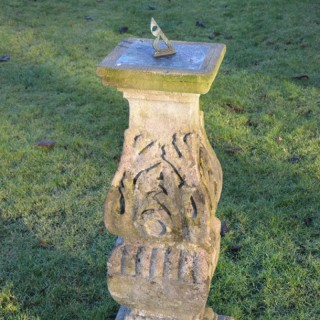A late 19th century carved Bath stone sundial