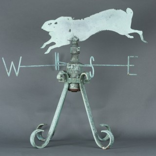 An early 20th century French weathered brass weather vane