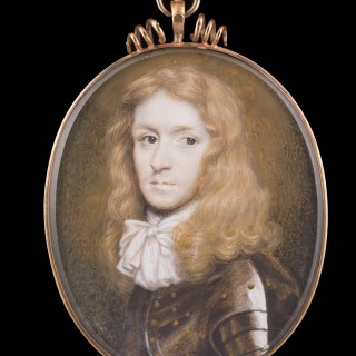 Portrait miniature of a Young Gentleman, wearing plate armour comprised of cuirass and spaulders secured with gilt rivets, elaborately tied with linen cravat