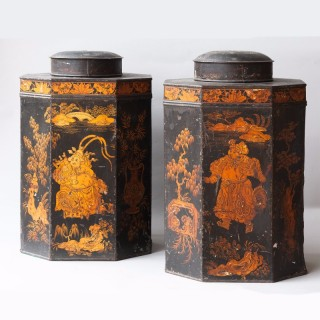 A PAIR OF OCTAGONAL REGENCY TOLE TEA CANISTERS AND COVERS IN CHINOISERIE STYLE