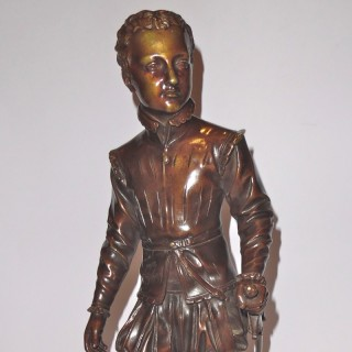 A French patinated bronze figure of Henri IV as a child