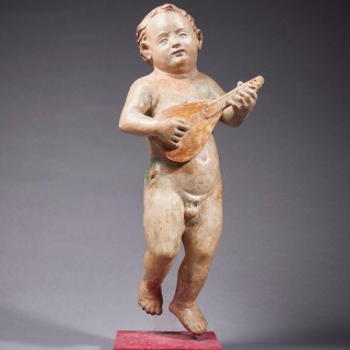 A Renaissance Putto Playing the Lute