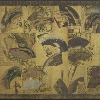 A two-fold paper screen painted in ink and colour on a gold ground with a patchwork of open and closed folding fans scattered in front of a cascading white wisteria