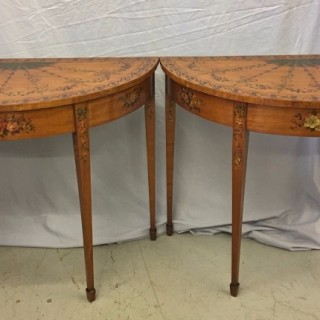 An Edwardian pair of painted satinwood console tables