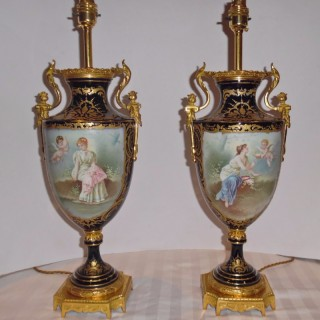 Pair of French ormolu mounted Sevres porcelain lamps