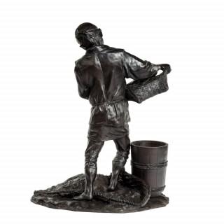 Meiji period bronze of a labourer