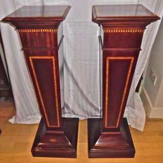 A pair of Edwardian mahogany pedestals