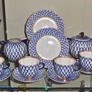 A Russian Imperial porcelain manufactory partial gilt tea service