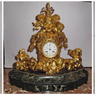 An impressive French ormolu and marble three piece clock set