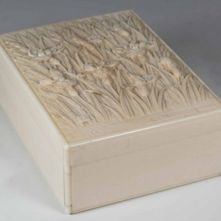 A FINELY CARVED JAPANESE IVORY LIDDED BOX BY KIYOCHIKA