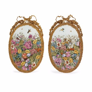 Pair of Sèvres style porcelain plaques with ormolu frames