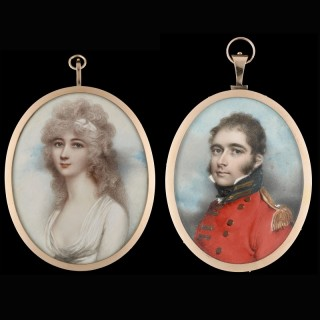 pair of portrait miniatures of John Crewe, later 2nd Baron Crewe (c.1772-1835), dressed in scarlet uniform with gold epaulette, and his wife Henrietta Maria Ann Hungerford (1772-1820) dressed in white with a white bandeau in her powdered hair