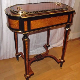 A Victorian amboyna and ebonised jardiniere
