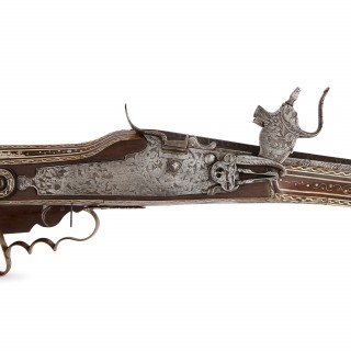 Silver, gold and mother-of-pearl inlaid walnut wheellock rifle