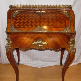 A French Louis XV style kingwood bureau