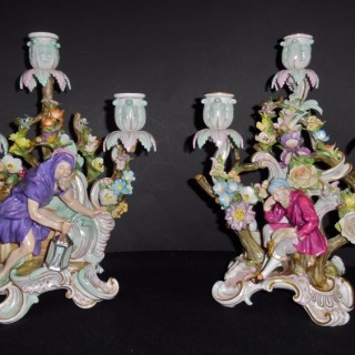 A pair of 19th Century Meissen porcelain candelabra