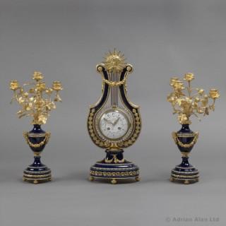 Louis XVI Style Cobalt Blue Porcelain and Lyre Clock Garniture