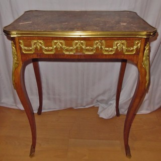 A French ormolu mounted marble top side table