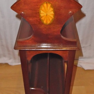 An Edwardian mahogany book troph