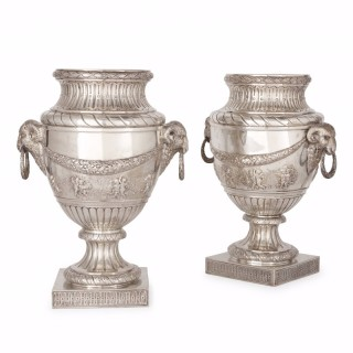 Large pair of antique solid silver vases