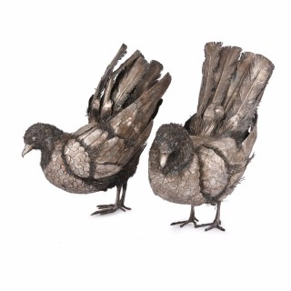 Pair of silver models of birds in the style of Buccellati