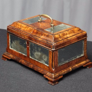 Early 18th Century figured walnut and mirrored panel tea caddy