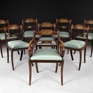 Set of eight Regency Simulated Rosewood and Brass Inlaid Dining Chairs