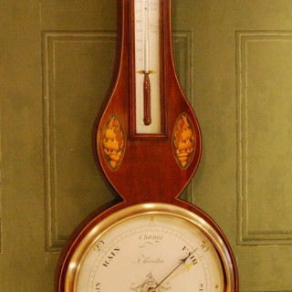 """George III Mahogany wheel barometer, eight inch dial, signed """"A.Rivolta, Chester"""