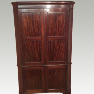 Geo III mahogany corner cabinet.