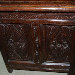 17th. century oak coffer with four panels to the lid